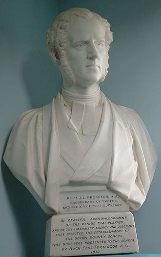 """Joseph Lloyd Brereton - Marble bust sculpted in 1861 by E.B. Stephens, on staircase of Memorial Hall, West Buckland School. Inscribed: """"Rev'd J.L. Brereton, MA, Prebendary of Exeter and Rector of West Buckland. In grateful acknowledgement of the genius that planned and of the liberality energy and judgement that effected the establishment of the Devon County School this bust was presented to the school by Hugh, Earl Fortescue KG 1861"""""""