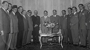 Suleiman Nabulsi's cabinet - King Hussein, Ali Abu Nuwar (Army Chief of staff) and Nabulsi's cabinet celebrating the annulment of the 1948 Anglo-Jordanian treaty, sometime in March 1957.
