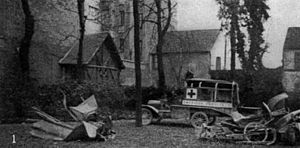 AFS Intercultural Programs - The remains of two ambulances destroyed by German shell-fire brought to Paris