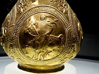 First Bulgarian Empire - A golden jug from the Treasure of Nagyszentmiklós depicting a warrior with his captive. Experts cannot agree if this warrior is Bulgar, Khazar or Avar