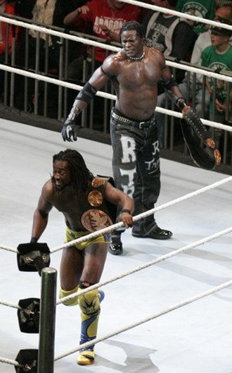Ron Killings - R-Truth (back) and Kofi Kingston as WWE Tag Team Champions