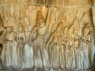 Krishna lifting Govardhan Hill (Bas relief in Mahabalipuram).JPG
