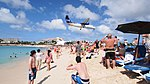 LIAT Dash 8-Q300 (V2-LGI) on short finals over Maho Beach.jpg