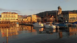 "Lachen, Switzerland - The marina of Lachen at sunset. Due to its western-facing position, Lachen is known as the ""town with the best sunset-views on lake Zurich""."