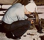 Landing gear repair on a North American SNJ at Naval Air Station Norfolk on 20 April 1945 (80-G-K-4632) (cropped).jpg
