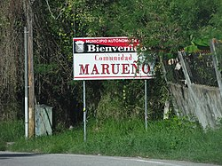 Sign marking the entrance to the main urban community in Barrio Marueño