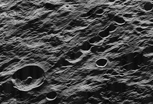 Leuschner (crater) - Oblique Lunar Orbiter 5 view of Leuschner (lower left) with Catena Leuschner (row of craters center to upper right), facing west