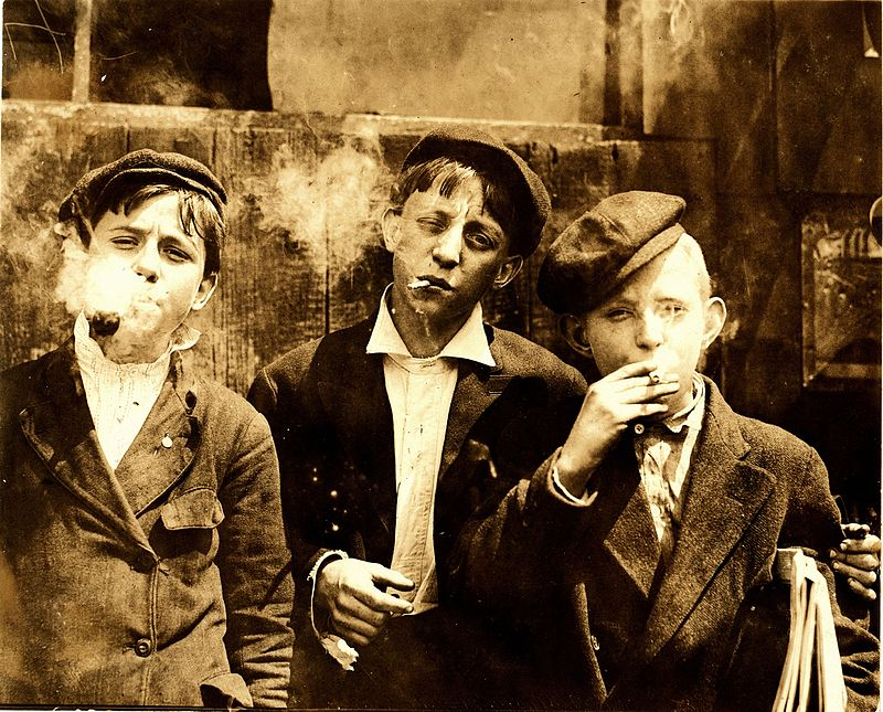 Lewis Hine, Newsies smoking at Skeeter%27s Branch, St. Louis, 1910.jpg