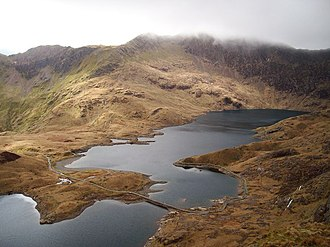 Snowdon - Llyn Llydaw, the largest and deepest lake on Snowdon's flanks, is crossed by a causeway at its eastern end