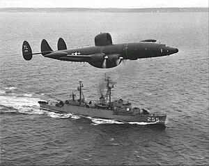 Lockheed WV-2 of VW-15 flies over USS Sellstrom (DER-255) off Newfoundland, in March 1957
