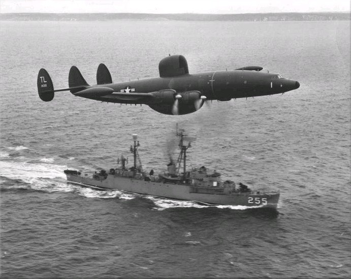 Lockheed WV-2 of VW-15 flies over USS Sellstrom (DER-255) off Newfoundland, in March 1957