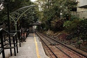 Dumplings (film) - MacDonnell Road Station of the Peak Tram appears in a scene of the film, when Mrs Li and Mei walk up the hill towards Mrs. Li's house.
