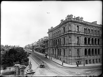 Macquarie Street, Sydney - The central section of Macquarie Street c.1900, looking south: the tall building on the right is the Colonial Secretary's Building, while on the left is the gate of the Royal Botanic Gardens leading to Government House and the Government House stables (now the Sydney Conservatorium of Music)