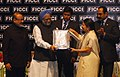 Manmohan Singh presenting award for excellency to the Director, of Grasim Industries Ltd (Cement Division-South), Tamil Nadu, Mrs. Rajashree Birla.jpg