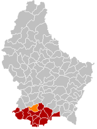 Map of Luxembourg with Reckange-sur-Mess highlighted in orange, and the canton in dark red