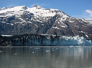 Margerie Glacier - Layers of rock debris are mixed with ice on the left side of the terminus