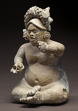 In Maya religion, the dwarf was an embodiment of the Maize God's helpers at creation. Mayan - Dwarf Figurine - Walters 20092036 - View A.jpg