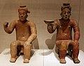 Messico, colima, figure sedute con un braccio alzato, 100-800 dc ca.jpg