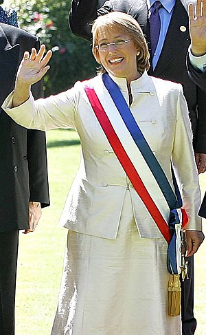 Socialist Party of Chile - Michelle Bachelet with the presidential flag.