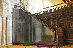 Minbar - Picture showing the minbar of the Great Mosque of Kairouan (Mosque of Uqba); this pulpit, the oldest in existence, is still in its place of origin (in the prayer hall of the mosque) and it is protected by a glass panel in order to preserve this precious preaching chair, in Kairouan, Tunisia.