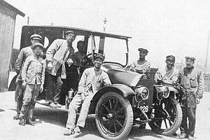 Mitsubishi Motors - Workers at Mitsubishi Shipbuilding Co., Ltd alongside one of the prototype Mitsubishi Model A automobiles.