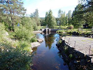 Moelva (Ringsaker) - This dam at Næroset marks the beginning of Moelva.