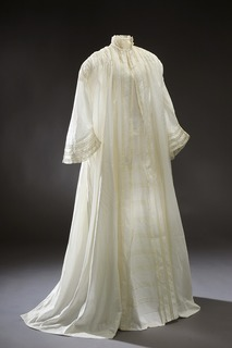 loose informal garment worn after bathing or at home