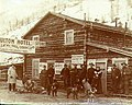Mrs Moulton and group of people outside the Moulton Hotel and store, Gold Bottom, Yukon Territory, ca 1898 (MEED 37).jpg