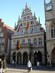 The Stadtweinhaus in Münster with banners displayed in mourning (note the black ribbons atop each mast) after the death of former German president Johannes Rau in 2006