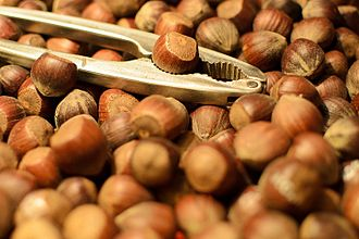 Nutcracker - Lever nutcrackers with hazelnuts