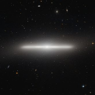 Galactic plane - This edge-on view of the galaxy NGC 4452 from Earth shows its galactic plane, with the nucleus at the center.