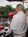 NOLA BP Oil Flood Protest brollys megaphone.JPG