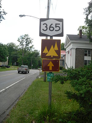 "New York State Route 365 - Sign assembly on NY 365 in Oneida County. The reference marker reads ""12C"" for NY 12C, the former designation of part of NY 365."