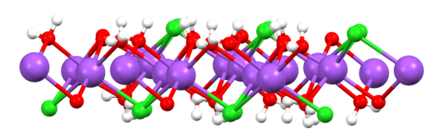 View of one slab of NaCl(H2O)2 (red = O, white = H, green = Cl, purple = Na). NaCl(H2O)2slab.png