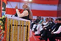 Narendra Modi addressing the gathering at Rickshaw Sangh programme by the Bhartiya Micro Credit, in Lucknow, Uttar Pradesh. The Governor of Uttar Pradesh, Shri Ram Naik, the Union Home Minister.jpg