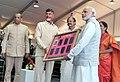 Narendra Modi being presented a memento by the Chief Minister of Andhra Pradesh, Shri N. Chandrababu, at foundation stone ceremony of Shri Venkateswara Mobile & Electronics Manufacturing Hub, in Tirupati.jpg