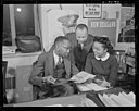 New York Post journalist Ted Poston working at the Office of War Information with his assistants William Clark and Harriette Easterlin.jpg