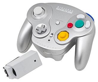 GameCube controller - Platinum WaveBird controller and receiver module.
