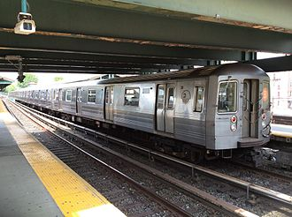 B (New York City Subway service) - A train made of R68A cars in B service at Kings Highway, bound for Manhattan.