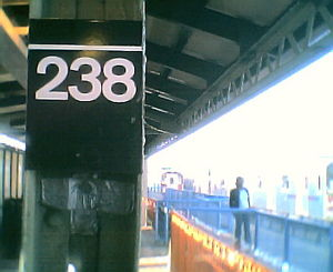 Old 238th Street sign at Nereid Avenue Station.jpg