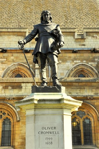 1899 statue of Oliver Cromwell, Westminster by Hamo Thornycroft outside the Palace of Westminster, London Oliver Cromwell statue, Westminster.jpg