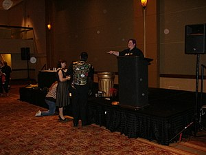 "Origins Game Fair - ""Alan Smithee"" (the man in the gaudy jacket) consulting with his helpers at the 2007 Smithee Awards at the Origins International Game Expo"