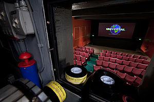 Movie theater -  The view from the projectionist's booth at Ultimate Palace Cinema in Oxford. The picture the projector is displaying is the 1997 Universal Pictures Logo.