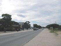 Ozzys Beerhouse and Eugen Kakukuru Street in Rundu, Namibia, March 2006.jpg