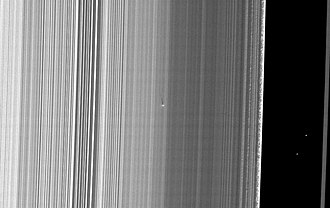 S/2009 S 1 - The bright dot with a long shadow in the center is S/2009 S 1. The Cassini Division is on the right.