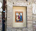 Painted ceramic on a wall in Assisi.jpg