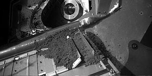 Thermal and Evolved Gas Analyzer - Martian soil being delivered to TEGA