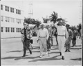 Photograph of President Truman walking to the beach in the morning during his vacation at Key West, Florida, with... - NARA - 200572.tif