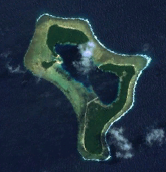 Pingelap - A satellite image of the Pingelap atoll at low-tide. The pale strip in the centre is the airstrip.