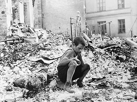 Survivor of bombing of Warsaw Polish kid in the ruins of Warsaw September 1939.jpg